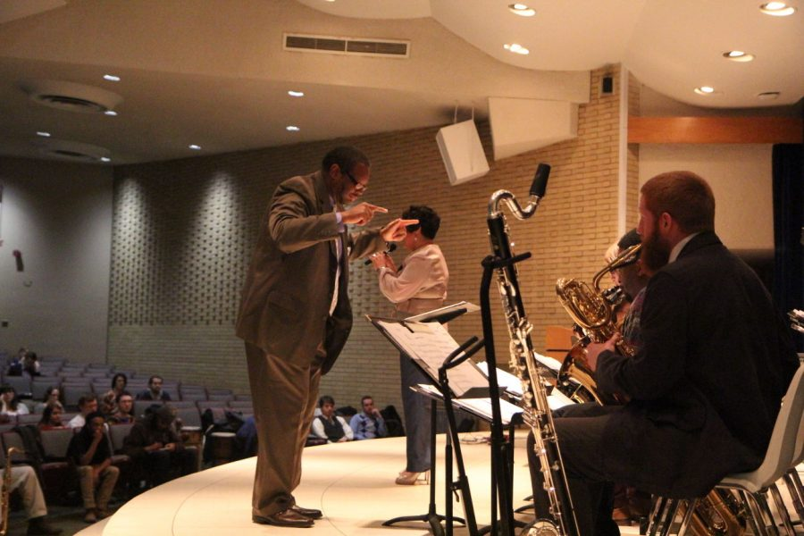 Jazz studies director Reggie Thomas conducts the NIU Jazz Ensemble while his wife, Mardra Thomas, performs vocals at a Martin Luther King Jr. tribute show Jan. 19. The group performed a protest song by Billie Holiday.