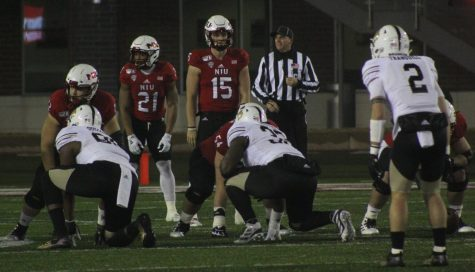 Huskie offense prepares for its next play Tuesday during a home game against Western Michigan University at Huskie Stadium.