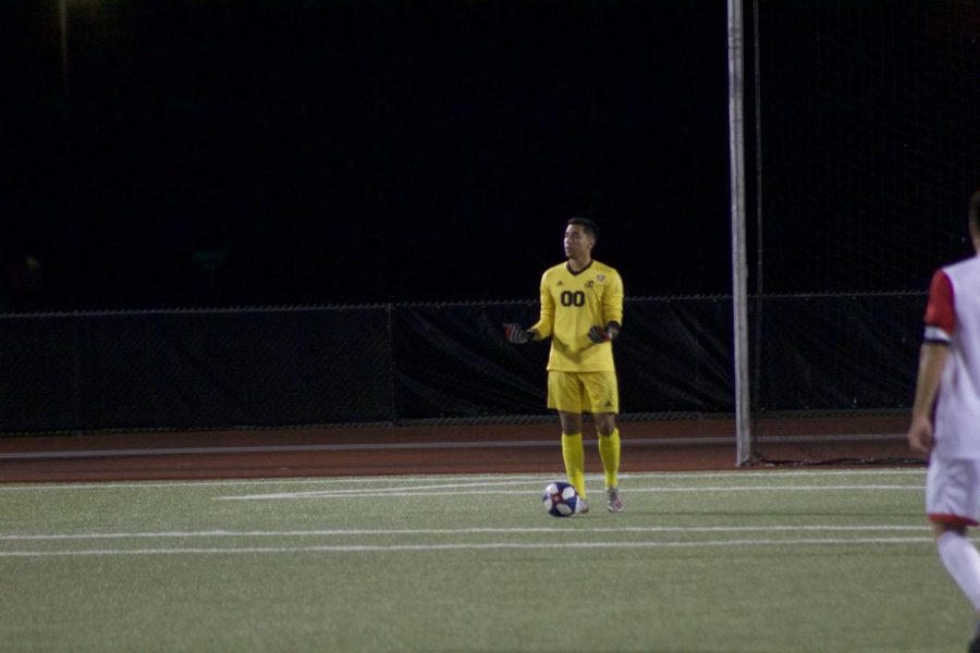 Martin Sanchez, redshirt first-year goalkeeper, keeps the ball close while looking for an open teammate Oct. 8 during NIU's 5-1 victory against Eastern Illinois University at the Soccer and Track and Field Complex.