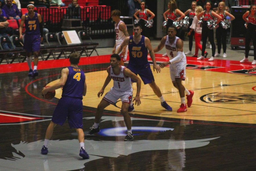 The Huskie defense locks down UNI sophomore guard AJ Green Saturday during NIUs 64-54 loss against University of Northern Iowa at the Convocation Center.