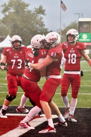 Huskies celebrate after a touchdown Oct. 26 during NIU's 49-0 win against the University of Akron at Huskie Stadium.