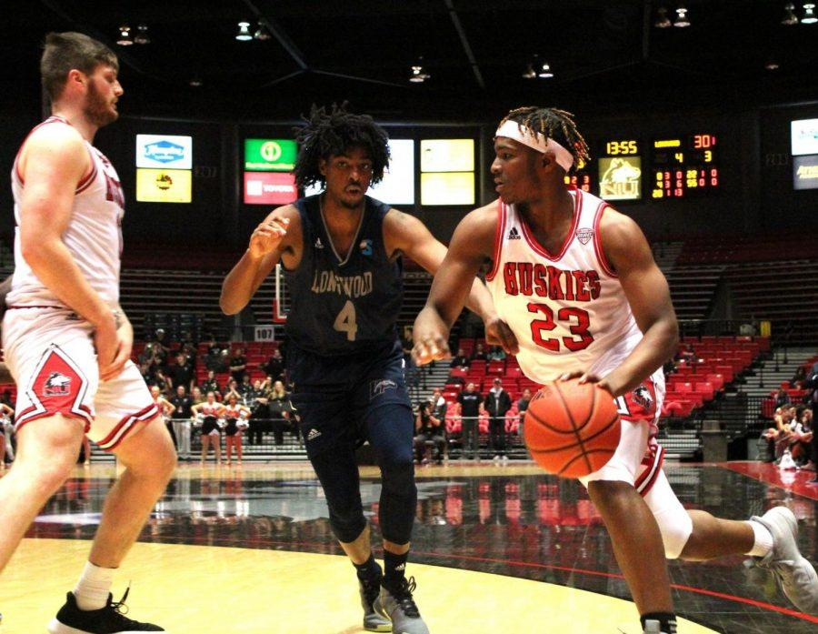 Then-first-year guard Tyler Cochran looks to get the edge on a screen Monday during NIU's 65-48 win against Longwood University at the Convocation Center.