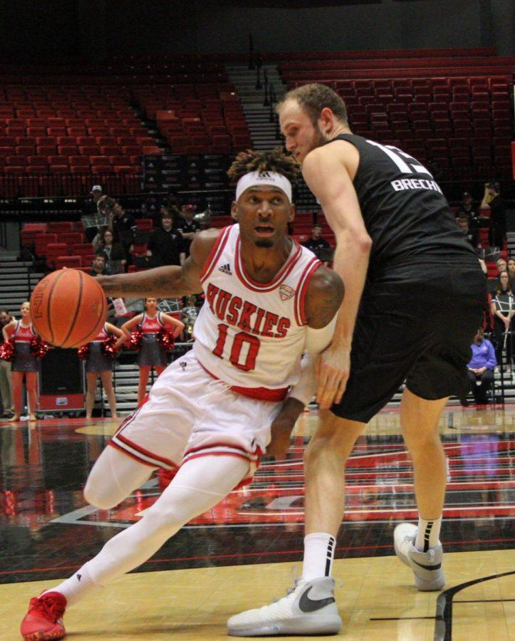 Senior guard Eugene German drives to the basket Monday during NIU's home victory against Oakland University at the Convocation Center.