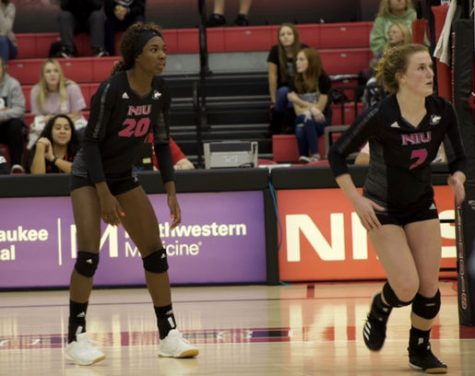 Junior middle blocker Kennedy Wallace and sophomore setter Grace Balensiefer await an opponent's attack Oct. 25 during NIU's 3-1 victory against Kent State University at the Convocation Center.