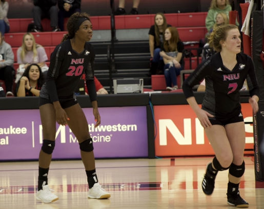 Senior middle blocker Kennedy Wallace and Junior setter Grace Balensiefer await an opponent's attack Oct. 25, 2019.