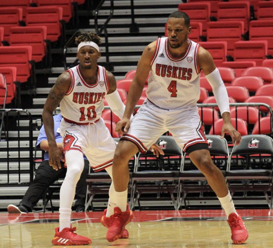 Senior guard Eugene German and redshirt senior forward Lacey James take a defensive position Tuesday during NIU's 85-50 win against Roosevelt University at the Convocation Center.