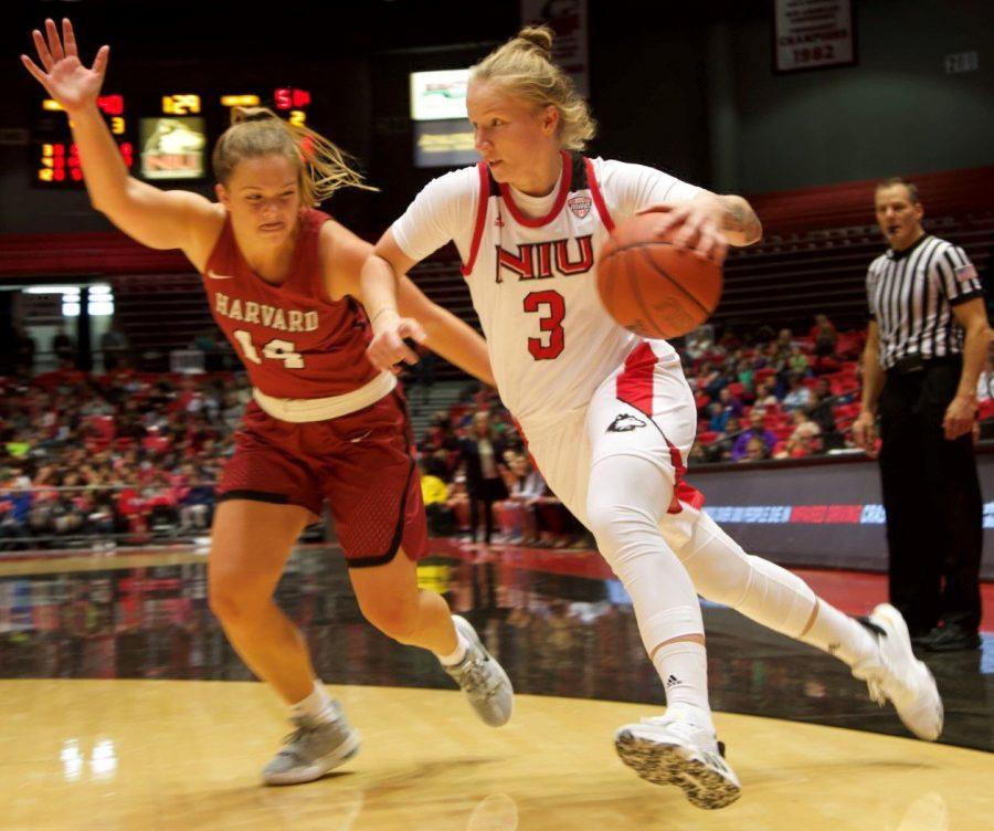 Junior+guard+Gabby+Nikitinaite+%28right%29-+leans+in+for+a+drive+to+the+basket+Nov.+5+during+NIU%E2%80%99s+season-opening+loss+against+Harvard+University+at+the+Convocation+Center.