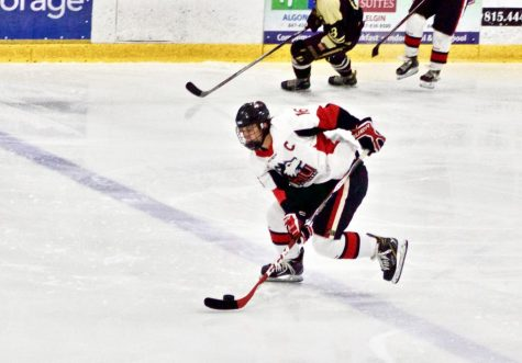 Senior forward Brad Krauser skates in a counter attack Sept. 27 during a 3-2 loss to Western Michigan University at the Canlan Ice Center in West Dundee.