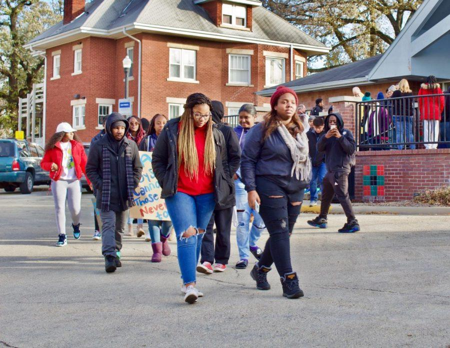 Protesters march Saturday outside the Center of Black Studies. NIU's NAACP chapter organized a march against perceived unequal treatment by the City of DeKalb police department.