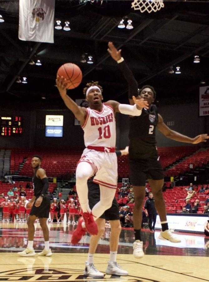Senior guard Eugene German gets up and under defenders Nov. 25 during NIU's home win against Oakland University at the Convocation Center.