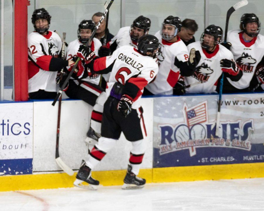 First-year forward Nick Gonzalez celebrates with his team Sept. 27 during NIU's home loss against Western Michigan University at the Canlan Ice Sports.