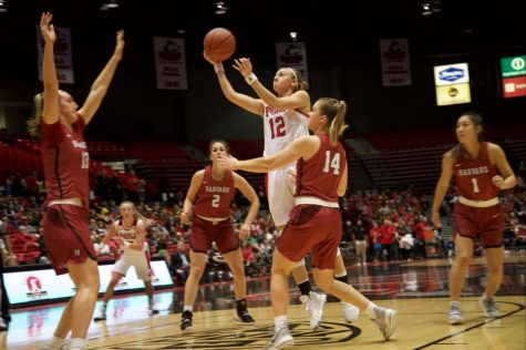 Junior forward Riley Blackwell reaches for a layup Nov. 5 during NIU's home loss to Harvard University at the Convocation Center.