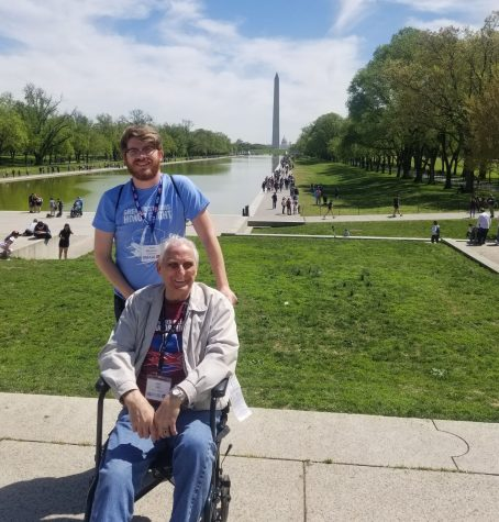 Northern Star contributor Jack Baudoin (back) stands in front of the Washington Monument with his grandfather, James Hill, April 20 in Washington D.C.