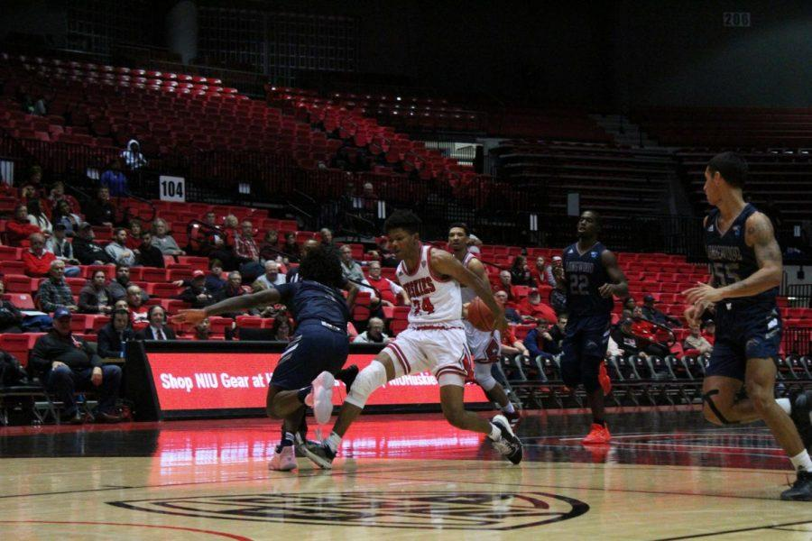 Sophomore Darius Beane (middle) drives past a Longwood defender Nov. 18 during NIU's 65-48 win over Longwood University at the Convocation Center.