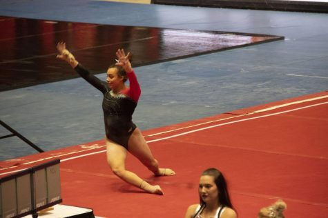 Junior Morgan Hooper performs her floor routine Friday during NIU's loss to Western Michigan at the Beauty and the Beast event at the Convocation Center.