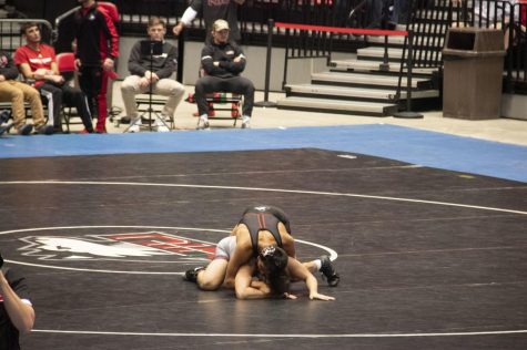 First-year Izzak Olejnik (top) attempts to pin his opponent Friday during NIU