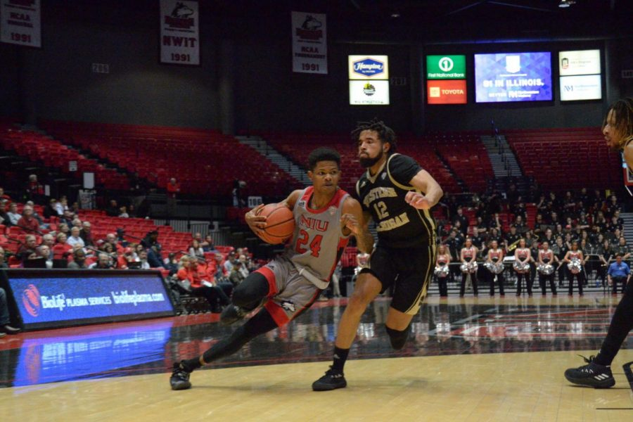 Then+sophomore+guard+Darius+Beane+drives+to+the+basket+in+a+Jan.+25+game+against+Western+Michigan+University+at+the+NIU+Convocation+Center.+Beane+scored+13+points+in+the+last+game+against+UIC.