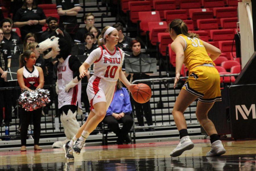 First-year guard Chelby Koker drives past a Golden Flash defender Wednesday during NIU's 79-71 loss to Kent State University at the Convocation Center.