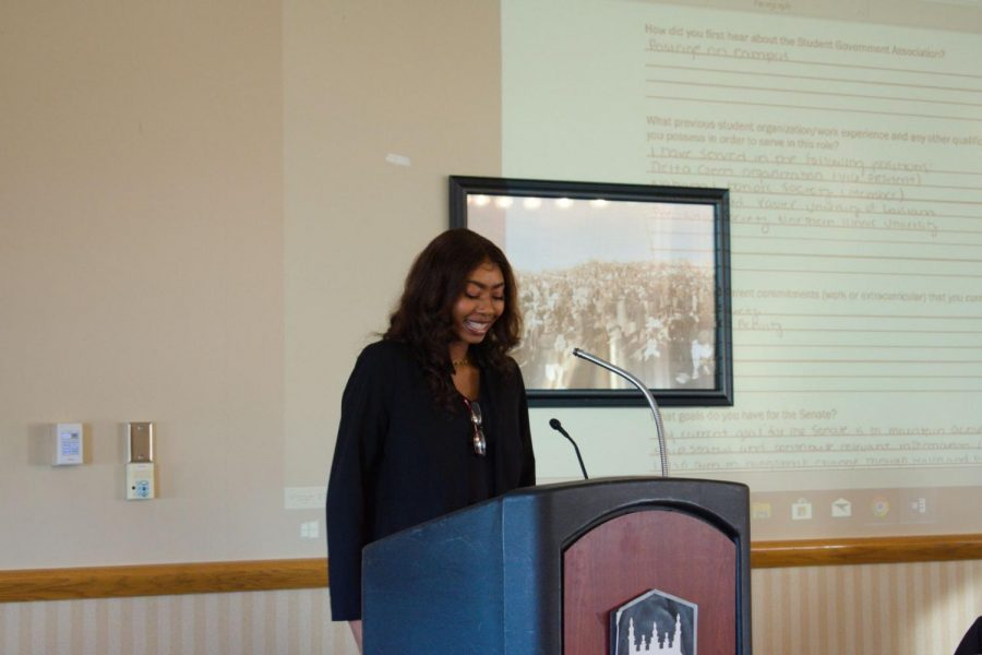 Janai Crumbley, sophomore philosophy and psychology double major, speaks at the SGA Senate meeting Sunday. Crumbley and Michael Verlinsky, junior finance major, were appointed to the SGA Senate's body during the meeting.