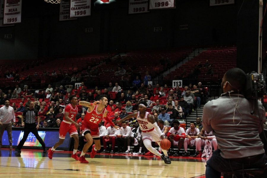 Senior Eugene German (right) drives along the baseline Feb. 1 during NIU's 70-55 win over the Miami University-Ohio RedHawks at the Convocation Center.