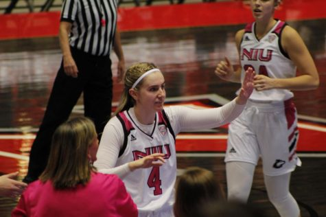 Redshirt senior forward Courtney Woods high-fives her teammates during a Feb. 12 game against Miami University-Ohio at the Convocation Center.