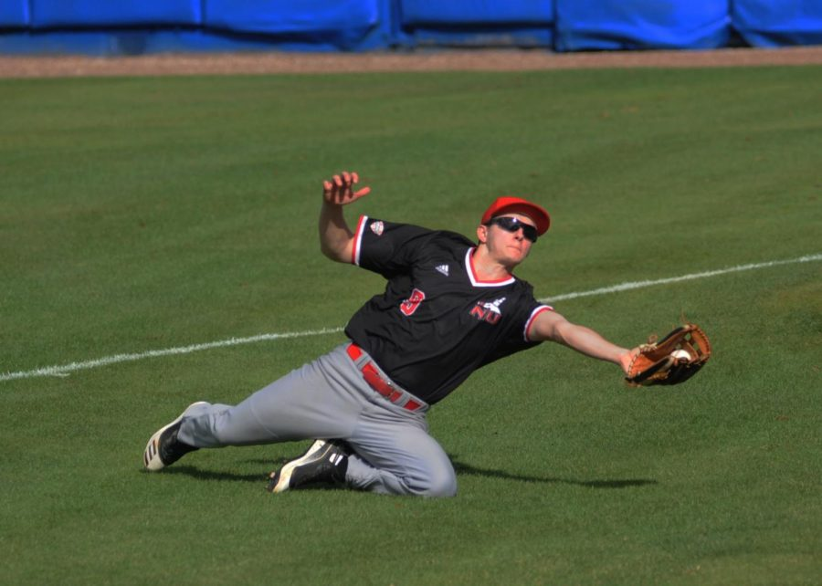 Sophomore outfielder Nick Drobushevich makes a sliding catch during NIU's Feb. 15 game against Boston College University in Winter Haven, Florida.