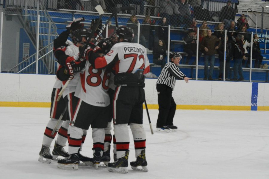 A group of Huskies celebrate a goal during a Jan. 10 game against Kent State University at Canlan Ice Sports in West Dundee.