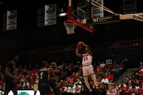 Sophomore Darius Beane (no.24) drives under the basket Feb. 7during NIU's 57-54 win over Kent State University at the Convocation Center.