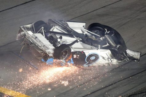 Ryan Newman slides down the track after he was involved in a crash on the final lap of the NASCAR Daytona 500 auto race at Daytona International Speedway, Monday, Feb. 17, 2020, in Daytona Beach, Fla. Sunday's race was postponed because of rain. (AP Photo/David Graham)