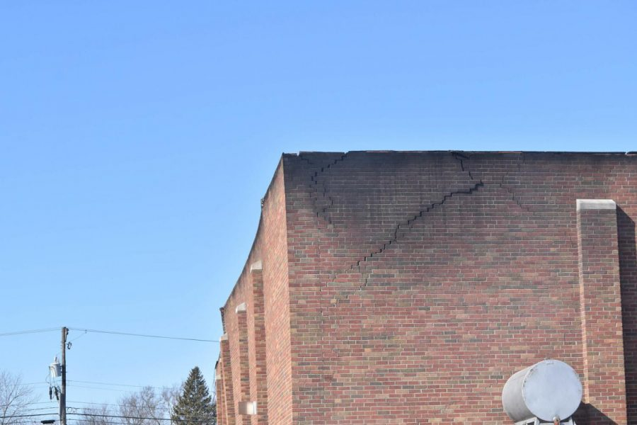 Burn marks on the Standard Roofing Company building's siding.
