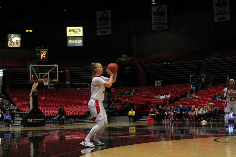 Junior Gabby Nikitinaite attempts a 3-point shot Feb. 1 during NIU's 64-63 win over the University at Buffalo Bulls at the Convocation Center.