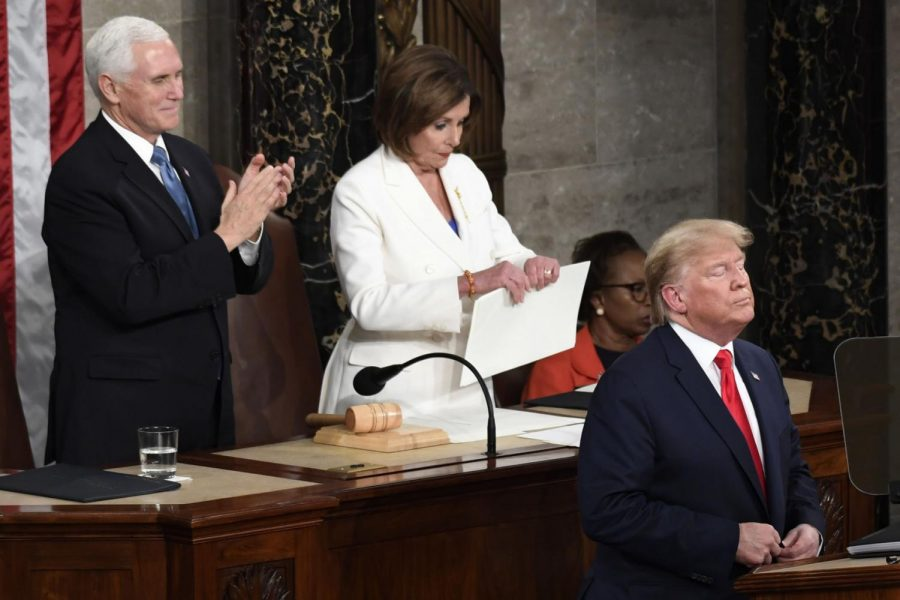 House Speaker Nancy Pelosi (right), tears her copy of President Donald Trump's State of the Union address Tuesday after he delivered it to a joint session of Congress on Capitol Hill in Washington.