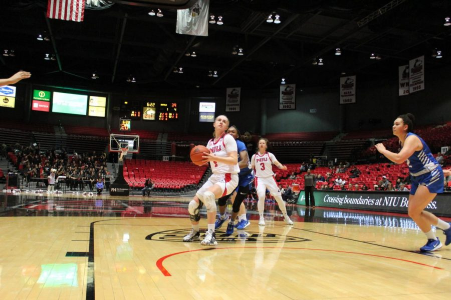 Redshirt senior Courtney Woods (front) drives through the lane on her way to a layup Feb. 1 during NIU's 64-63 win against the University at Buffalo at the Convocation Center.