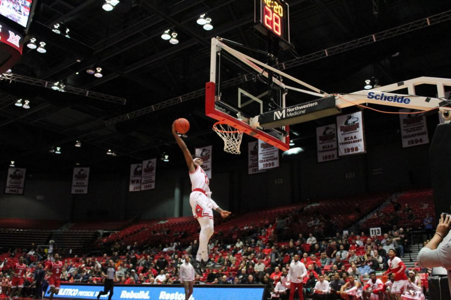 Senior Eugene German sails through the air on his way to a slam dunk after picking up a steal to start a fast break Feb. 1 in NIUs Game against Miami University-Ohio at the Convocation Center.