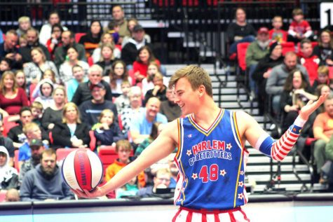 Globetrotter Dazzle Kidoń does tricks with a basketball Thursday during the Harlem Globetrotters game at the Convocation Center.