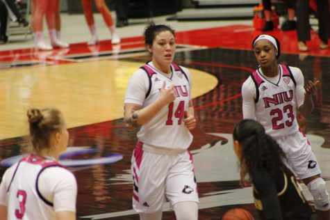 Senior forward Mikayla Brandon (from the left) and Myia Starks get back on defense Feb. 15 during NIU's 68-65 loss to the Western Michigan University Broncos at the Convocation Center.