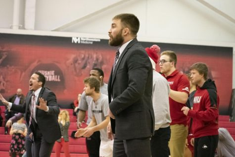 Associate Head Coach Dominick Moyer coaches the wrestling team Feb. 14 during NIU's 19-16 win over the University at Buffalo. The meet took place at Victor E. Court.