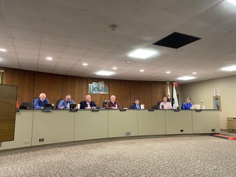DeKalb city council members (left to right) Bill Finucane, Tracy Smith, Greg Perkins, mayor Jerry Smith, Scott McAdams, Mike Verbic and Tony Faivre meet Jan. 27 at a city council meeting after a lower bar age limit ordinance was proposed at a Jan 13. meeting.