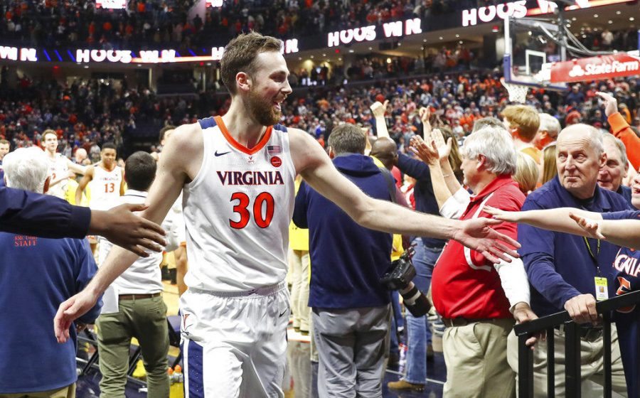 Virginia+forward+Jay+Huff+%2830%29+celebrates+with+fans+after+defeating+Duke+in+an+NCAA+college+basketball+game+Saturday%2C+Feb.+29%2C+2020%2C+in+Charlottesville%2C+Va.+%28AP+Photo%2FAndrew+Shurtleff%29
