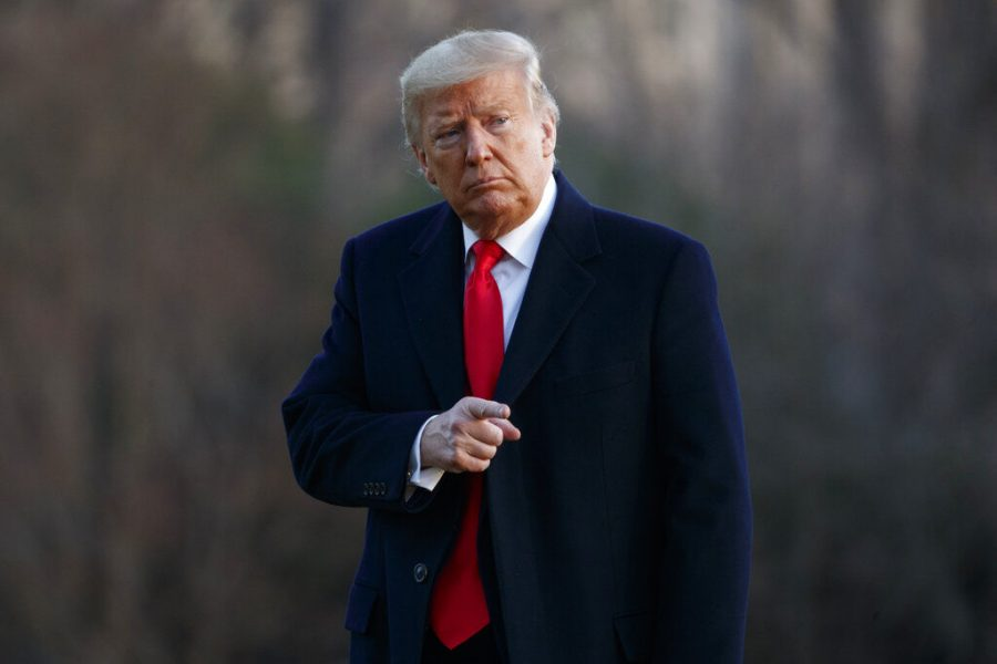 President Donald Trump points to the media as he arrives at the White House in Washington, Saturday, Feb. 29, 2020, on Marine One as he returns from speaking at the Conservative Political Action Conference.