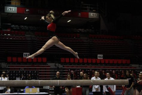 Junior Mia Lord performs a beam rountine March 1 during NIUs meet against Southeast Missouri State University at the Convocation Center.
