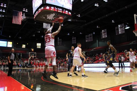 First-year guard Tyler Cochran attempts a 3-pointer Feb. 7 during NIU's 57-54 win over Kent State University at the Convocation Center.