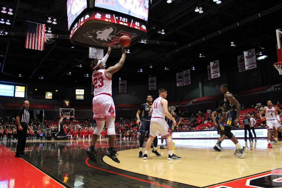 First-year guard Tyler Cochran attempts a 3-pointer Feb. 7 during NIU
