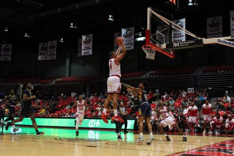 Redshirt senior forward Lacey James attempts to finish an alley-oop Feb. 7 during NIU