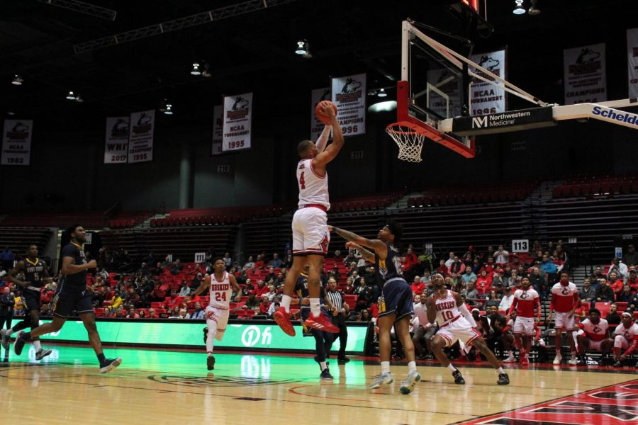 Redshirt senior forward Lacey James attempts to finish an alley-oop Feb. 7 during NIU's game against Kent State University at the Convocation Center.