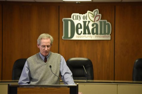 City Manager Bill Nicklas speaks to DeKalb business owners Tuesday at an emergency meeting to address the state-wide ban on dine-in service.