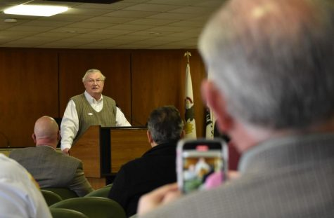Mayor Jerry Smith addresses business owners regarding the possibility of looting in the county.