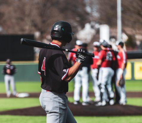An NIU baseball player prepares to bat during a 2020 season game.
