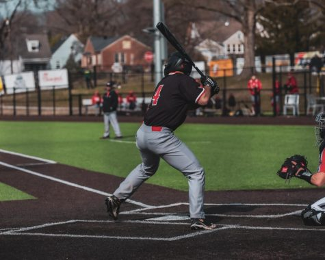 NIU baseball player Jake Dunham bats.