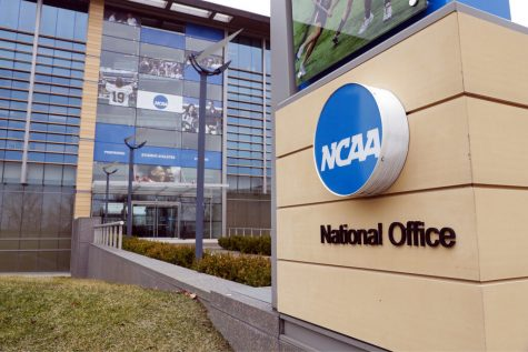 FILE - In this March 12, 2020, file photo, The national office of the NCAA in Indianapolis is viewed. The NCAA will permit spring sport athletes _ such as baseball, softball and lacrosse players _ who had their seasons shortened by the coronavirus outbreak to have an additional year of eligibility. The NCAA Division I Council voted Monday, March 30, 2020, to give spring sport athletes regardless of their year in school a way to get back the season they lost, but did not guarantee financial aid to the current crop of seniors if they return to play next year. (AP Photo/Michael Conroy, File)